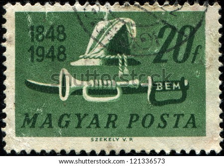 HUNGARY - CIRCA 1948: A stamp printed by Hungary honoring Centenary of Insurrection, shows Shako, trumpet and sword , circa 1948