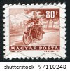 HUNGARY - CIRCA 1964: A stamp printed by Hungary, shows Motorcycle messenger, circa 1964 - stock photo
