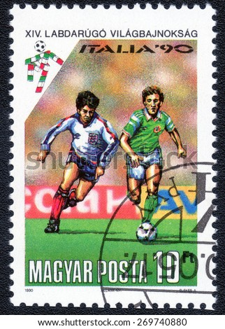 HUNGARY - CIRCA 1990: A stamp printed in Hungary dedicated to the soccer world championship in Italy, circa 1990  - stock photo