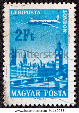 """HUNGARY - CIRCA 1966: A stamp printed in Hungary from the """"Plane over Cities served by Hungarian Airways"""" issue shows London, circa 1966. - stock photo"""