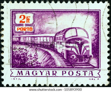 """HUNGARY - CIRCA 1973: A stamp printed in Hungary from the """"Postal Operations"""" issue shows a Diesel mail train, circa 1973. - stock photo"""
