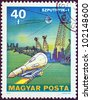 "HUNGARY - CIRCA 1977: A stamp printed in Hungary from the ""Space Research"" issue shows Sputnik 1, circa 1977. - stock photo"