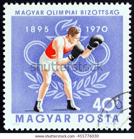 """HUNGARY - CIRCA 1970: A stamp printed in Hungary from the """"75th anniversary of Hungarian Olympic Committee """" issue shows boxing, circa 1970. - stock photo"""