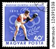 """HUNGARY - CIRCA 1970: A stamp printed in Hungary, shows Boxing and Olympic Rings, with inscription and name of series """"75th Anniversary of Hungarian Olympic Committee, 1895 - 1970"""", circa 1970 - stock photo"""