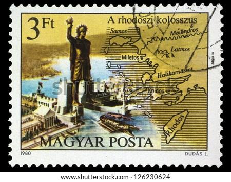 "HUNGARY - CIRCA 1980: A stamp printed in Hungary shows Colossos of Rhodes, with the same inscription, from the series ""Seven Wonders of the Ancient World"", circa 1980 - stock photo"