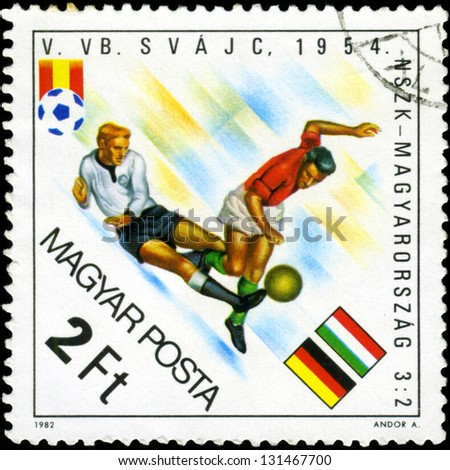 "HUNGARY - CIRCA 1982: A stamp printed in Hungary, shows football players, inscription ""Germany - Hungary 3:2, 1954"", circa 1982 - stock photo"