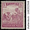"HUNGARY - CIRCA 1916: A stamp printed in Hungary shows Harvesting Wheat, from the series ""Harvesting Wheat"", 1916  - stock photo"