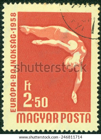 HUNGARY- CIRCA 1958: A stamp printed in Hungary shows High dive, series International Wrestling and European Swimming and Table Tennis Championships, held at Budapest circa 1958 - stock photo