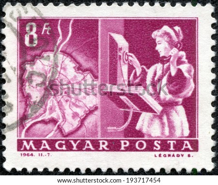 "HUNGARY - CIRCA 1964: A stamp printed in Hungary shows Map of Budapest and automatic dial phone, without inscription, from the series ""Transport and Telecommunication&q uot;, circa 1964."