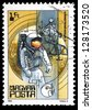 "HUNGARY - CIRCA 1982: A stamp printed in Hungary shows Neil Armstrong (first man on Moon) and Apollo 11, with the same inscription, from the series ""Space Research"", circa 1982 - stock photo"