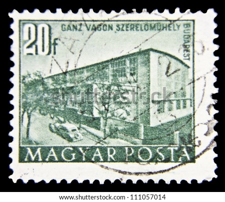 "HUNGARY - CIRCA 1951 : A stamp printed in Hungary shows Railroad Workshop, Budapest with the same inscription, from the series ""Budapest Buildings of the Five-Year-Plan"", circa 1951"