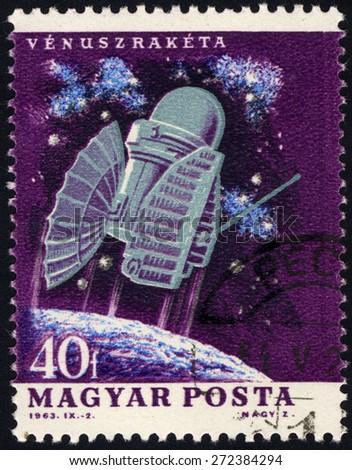 HUNGARY - CIRCA 1963: A stamp printed in Hungary shows spacecraft Venus space probe, series U.S. & USSR Spacecraft, circa 1963 - stock photo