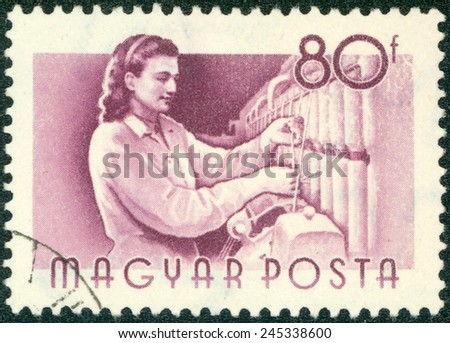 """HUNGARY - CIRCA 1955 : A stamp printed in Hungary shows Textile worker, without inscription, from the series """"Hungary Workers"""", circa 1955 - stock photo"""