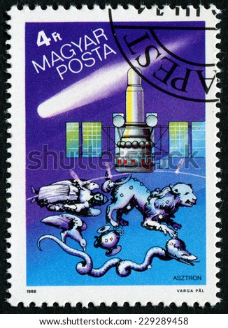 HUNGARY - CIRCA 1986: A stamp printed in Hungary shows the USSR's Astron UV and X-ray astrophysical observations satellite which studied Halley's Comet and several constellations, circa 1986.