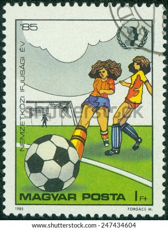 "HUNGARY - CIRCA 1985: A stamp printed in Hungary, shows Women Footballers, with inscription and name of series ""International Youth Year. 1985"", circa 1985 - stock photo"