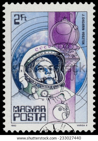 "HUNGARY - CIRCA 1982: A stamp printed in Hungary shows Yuri Gagarin (first man in space) and Vostok, with the same inscription, from the series ""Space Research"", circa 1982"