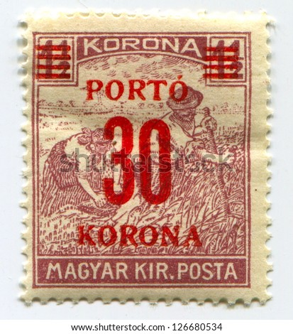 HUNGARY - CIRCA 1922: A stamp printed in Hungary with red print and dedicated to harvest, circa 1922.