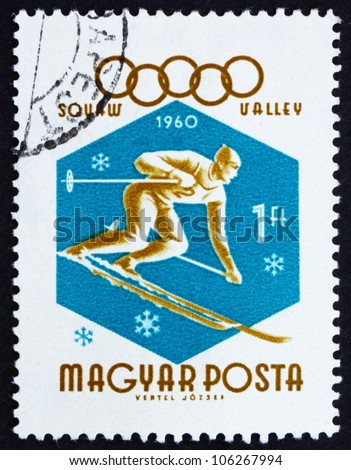 HUNGARY - CIRCA 1960: A stamp printed in the Hungary shows Downhill Skier, Winter Olympic sports, Squaw Valley 60, circa 1960 - stock photo