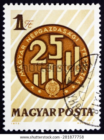 HUNGARY - CIRCA 1972: a stamp printed in the Hungary shows Graph, Planned National Economy, circa 1972 - stock photo