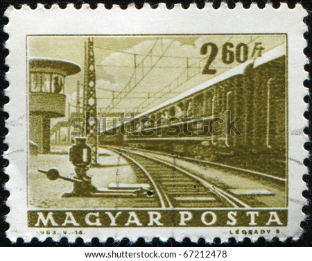 HUNGARY - CIRCA 1963: A stamp printed in the Hungary shows passenger train, circa 1963