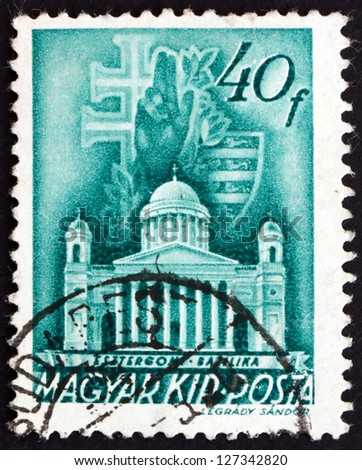 HUNGARY - CIRCA 1939: a stamp printed in the Hungary shows The Primatial Basilica of the Blessed Virgin Mary Assumed into Heaven and St. Adalbert, Esztergom, Budapest, circa 1939 - stock photo
