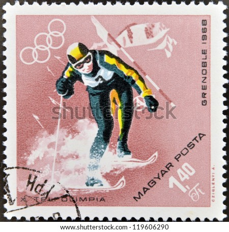 HUNGARY - CIRCA 1968: A stamps printed in Hungary showing an athlete skiing, Winter Olympic sports in Grenoble 1968, circa 1968 - stock photo