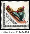 HUNGARY - CIRCA 1962: A stamps printed in Hungary showing racing motorcycle, series, circa 1962 - stock photo