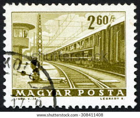 HUNGARY - CIRCA 1963: post stamp printed in Magyar shows railway and passenger train; Scott 1522 A337 2.60fo olive green, circa 1963