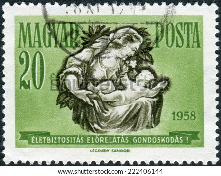 HUNGARY - CIRCA 1958: Postage stamp printed in Hungary, shows Mother and Child, circa 1958