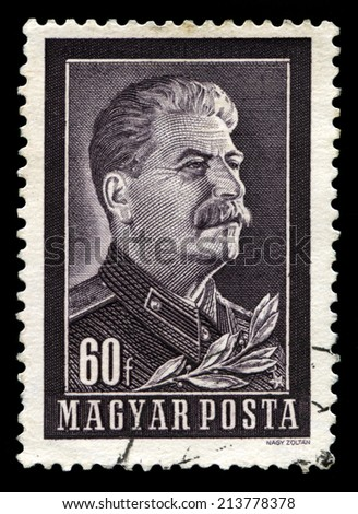 HUNGARY, CIRCA 1950s - A vintage Hungarian postage stamp featuring a portrait of Jospeh Stalin, circa 1950s. - stock photo