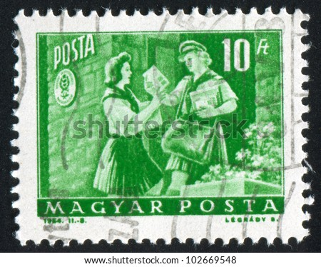 HUNGARY - CIRCA 1964: stamp printed by Hungary, shows girl pioneer and woman letter carrier, circa 1964 - stock photo