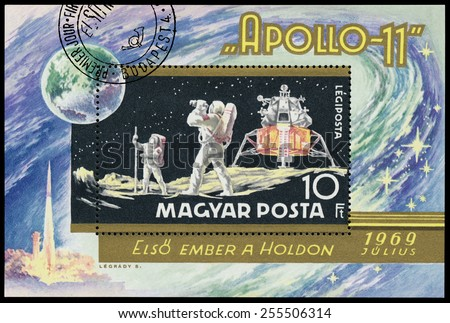 HUNGARY - CIRCA 1969: Stamp printed in Hungary, shows Apollo 11 with astronauts, circa 1969 - stock photo
