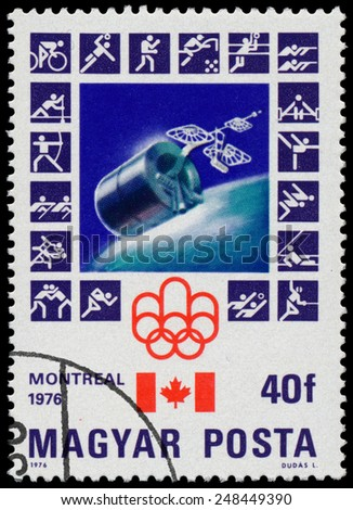 HUNGARY - CIRCA 1976: stamp printed in Hungary, shows Montreal Olympic Emblem, Canadian Flag, Intelstat 4, circa 1976