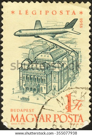 "HUNGARY - CIRCA 1958: stamp printed in Hungary, shows Plane over the Opera House, Budapest, the series ""Anniversary of Hungarian Air"", circa 1958 - stock photo"