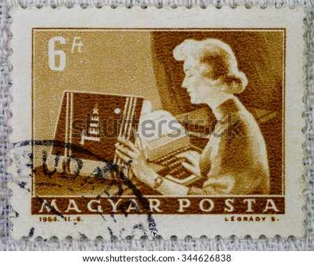 HUNGARY - CIRCA 1964 : used post stamp of Hungary . Texts of post stamp : Hungarian post ; 1964 ; Telex ; 6 Hungarian forints ; BUDAPEST . Image contains telex operator working in interior . - stock photo