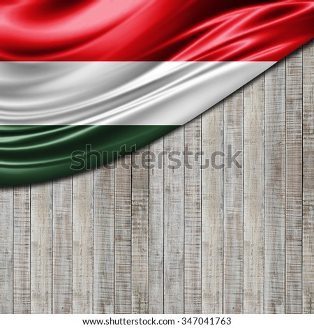 Hungary flag  of silk with copyspace for your text or images and wood background