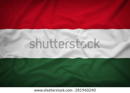 Hungary flag on the fabric texture background,Vintage style - stock photo