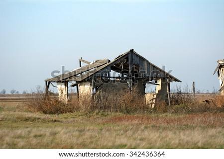 HUNGARY - NOVEMBER 17 : Ruined building on the plain at 17 November 2015 in Hungary. The Great Plain of Hungary is full of abandoned small settlements. - stock photo