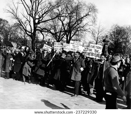 Hunger Marchers demonstrate in Washington DC Their placards read: 'We Demand Unemployment Insurance'; 'Free Milk for Workers children'; 'Tax the Rich for Unemployment Relief ''. - stock photo