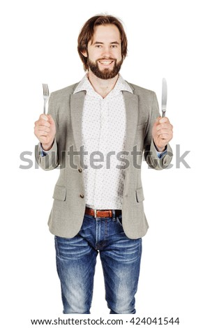 hungry beard man holding cutlery fork and knife on hand. diet, food, healthy, style concept. isolated on a white studio background.