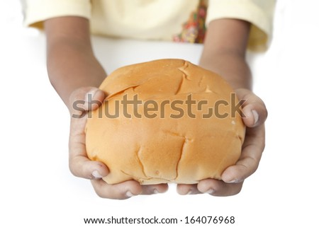 Hungry children's hands with a bread. Photo - stock photo