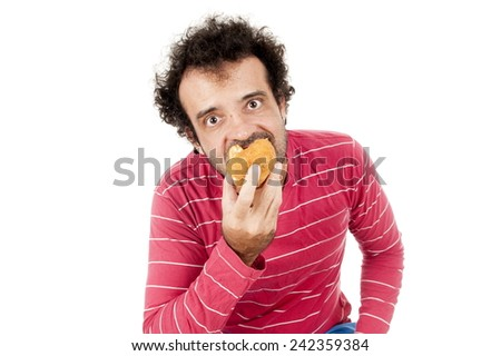 hungry crazy man eating . - stock photo