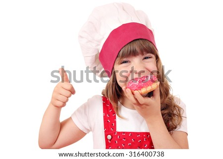 hungry little girl cook eat sweet donuts
