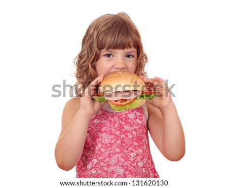 hungry little girl eat big sandwich on white