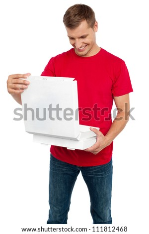 Hungry man looking at delicious yummy pizza delivered hot to him. All on white background