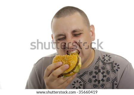 Hungry man with hamburger.