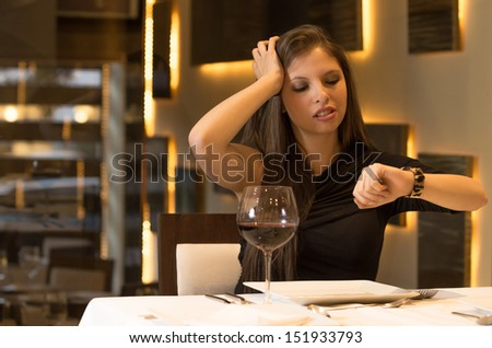 Hungry woman is waiting in a restaurant