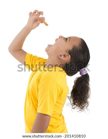 Hungry Young Girl Eating Biscuit Isolated on White Background - stock photo