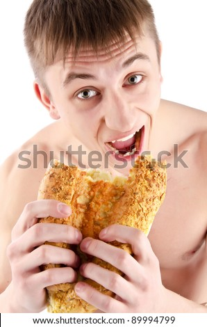 Hungry Young Man eating bread