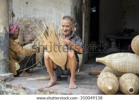 HUNGYEN, VIETNAM - JUNE 21 :Unidentified people weaving bamboo on June 21, 2015 in HungYen, Vietnam. Weaving this tools that used to catch fish is traditional occupation in Hung Yen province.